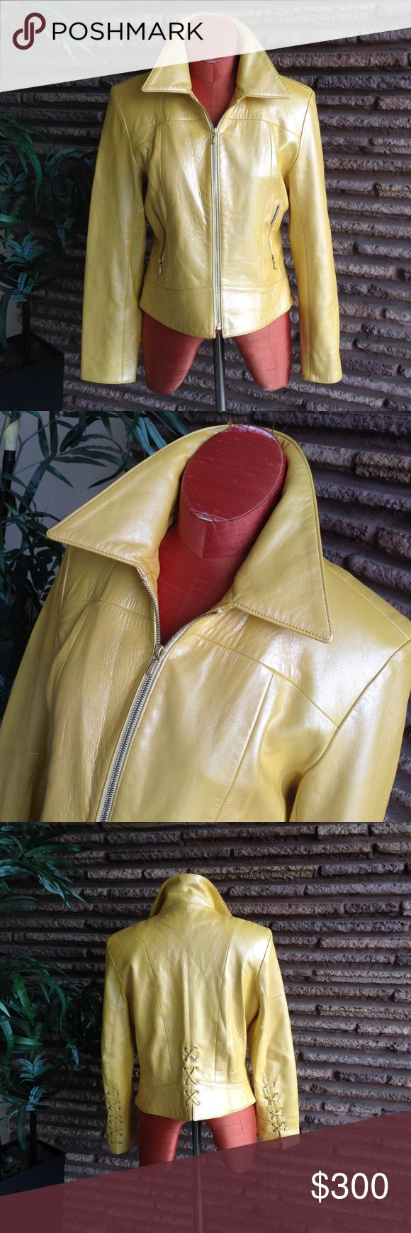 """Vintage Glove Soft Metallic Yellow Moto Jacket Fabulous fitted motorcycle styled jacket in a metallic golden yellow. This is from a boutique shop in San Francisco known for their quality leather goods. The leather is glove soft. Braided detail on the back as well as the cuffs  Maker: West Coast Leather Fabric: 100% Lambskin Listed Size:10 Measurements: Shoulder to shoulder : 17.5""""  Armpit to armpit:  20.5"""" Sleeve: 24.5"""" Length: 21.375""""  Condition:    A couple of marks on the cuff on one…"""