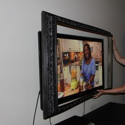 Mounting the frame on the TV. love the idea of using crown molding to bild frame ... will not however be using the 3m method :)