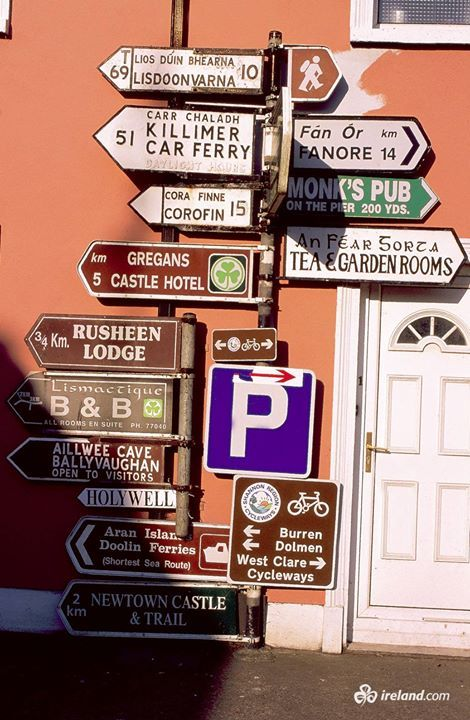 This is how we roll in Ireland! Road signs, Ballyvaughan, County Clare.