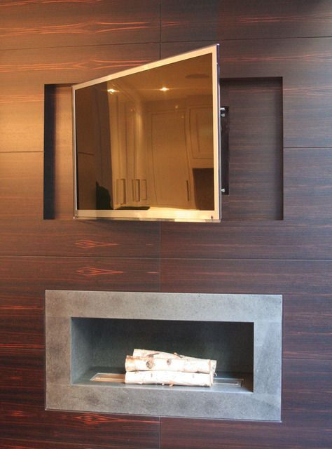 this wall is clad in wooden panels and very cleverly, the TV has a section carved out to house it, making it level with the wall and on a bracket to facilitate re-positioning should that need to be done