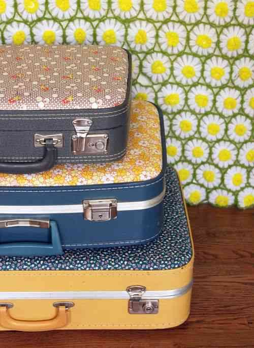 DIY Suitcase - Cover the sides of older suitcases with fabric.  They make attractive storage containers that you don't have to hide.  Tutorial on site.