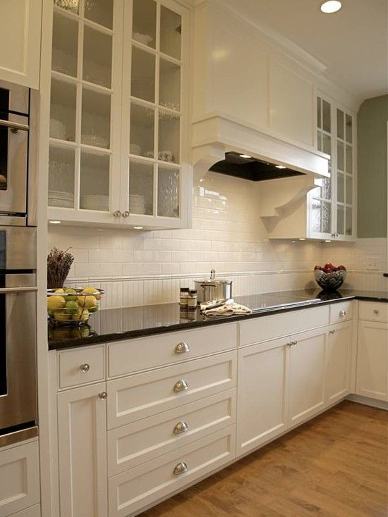 source: Alethea Sadowski Charming kitchen with sage green walls paint  color, white glass-