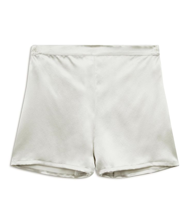 Lacewing Silver Silk Shorts £139 - Our Silver Silk Pyjama Shorts are one of our favourites. These perfect silk pyjama shorts – with just a hint of retro inspiration – are short enough to be sexy but long enough that you won't mind opening the front door. They sit just below the waist but are not low cut and the smooth, flat fronted waistband and softly elasticated back mean they fit like a dream. Wear them at night, in the morning or to add a bit of zap to an evening jacket.