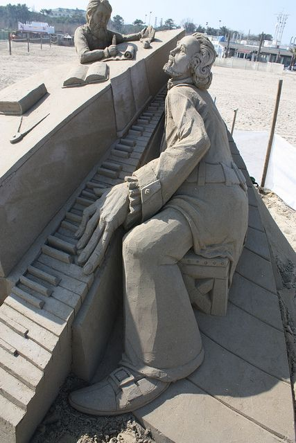 Sand Art, Man playing piano. In the Tampa Bay Area there is a good bit of sand art activity. This one would stand out anywhere.