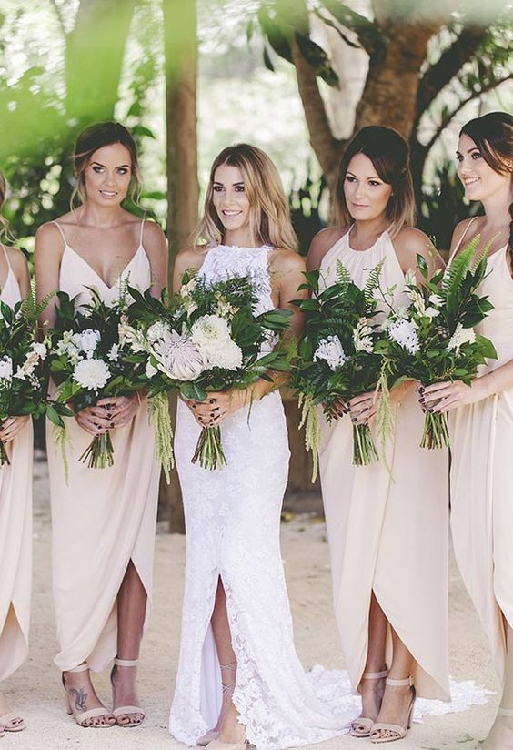 Featured Photographer: Kat Stanley Photography; Chic nude toned wrapped design bridesmaid dresses;
