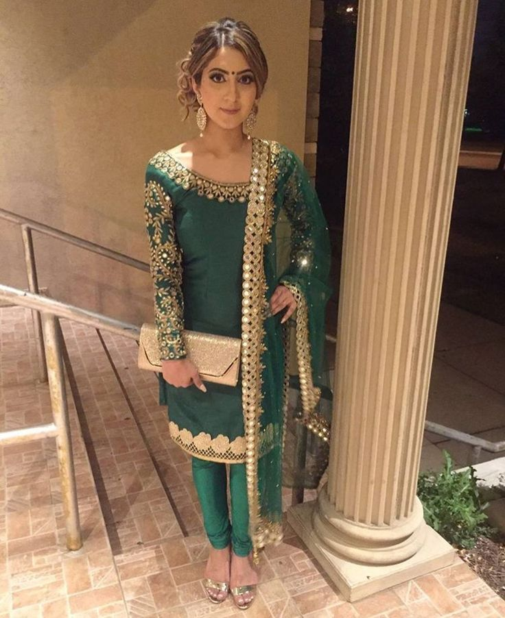 Love the gold embroidery against the deep emerald shade of this piece by Ghungat Fashions.