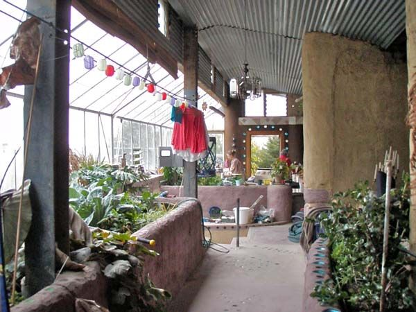 a beautiful garden/atrium an earthship home