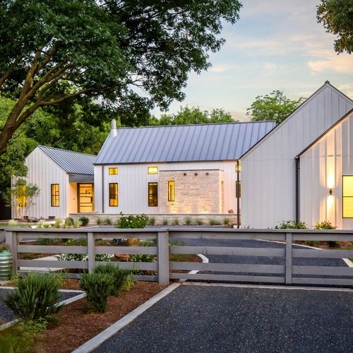 """Just West of Preston Hollow, you will find yourself gazing upon a modern farmhouse that feels like a Napa Valley Estate nestled amongst the large Pecan and Oak Trees of """"rural"""" Dallas. The simple"""