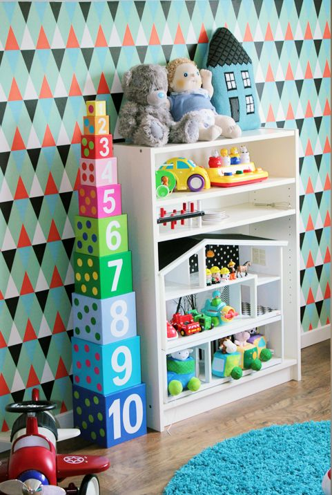 Kidsroom playroom colorful and playful. Isak wallpaper and Lundby dollshouse as storage for cars.