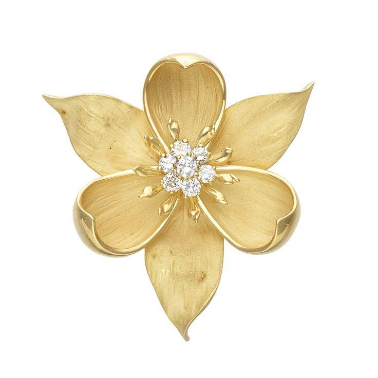 Gold and Diamond Flower Pendant-Brooch  18 kt., 7 round diamonds ap. .65 ct., ap. 15.3 dwts.