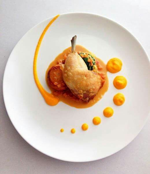 Confit chicken maryland braised cabbage and spinach, potato fondant, spiced carrot purée, chicken cream jus