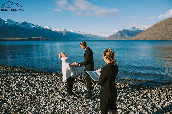 Queenstown 4wd wedding package with lakeside ceremony. Bride wears jeans and poncho