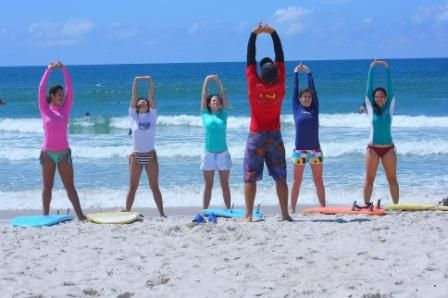 Surfers need this warm-up to get ready for more surfing lessons to learn at learntosurf.travel