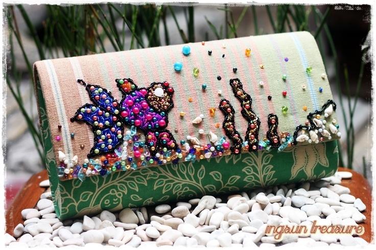 Gold fish stamped batik and natural dye NTB tenun collaborate on a clutch bag.    #clutchbag #clutch #batikbag #indonesia #ethnicbag #traditional #batik