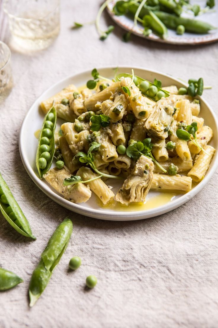 30 Minute Artichoke and Pea Rigatoni Pasta: This pasta is everything you want out of pasta, it's quick, light, and uses mostly pantry staple ingredients, yet still feels extra fresh, hearty and crave worthy...and of course, it's DELICIOUS! @halfbakedharvest.com
