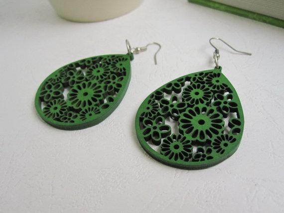 green wooden earrings. great use of a laser cutter.