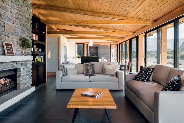 Glu-lam trusses in the open-plan living area match the columns on the verandah.