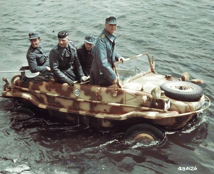 General der Panzergruppe Maximilian von Edelsheim and other officers leave in their command VW Schwimmwagen for the far side of the River Elbe to convey the terms of surrender to their subordinate commanders. They have just left the city hall of Stendal, Germany, where Major Frank Keating, 102nd Infantry Div. and Major General James Moore, Chief of Staff US 9th Army gave them the terms for the German XXXXVIII Panzerkorps of which Edelsheim commanded at the time. May 4 1945.