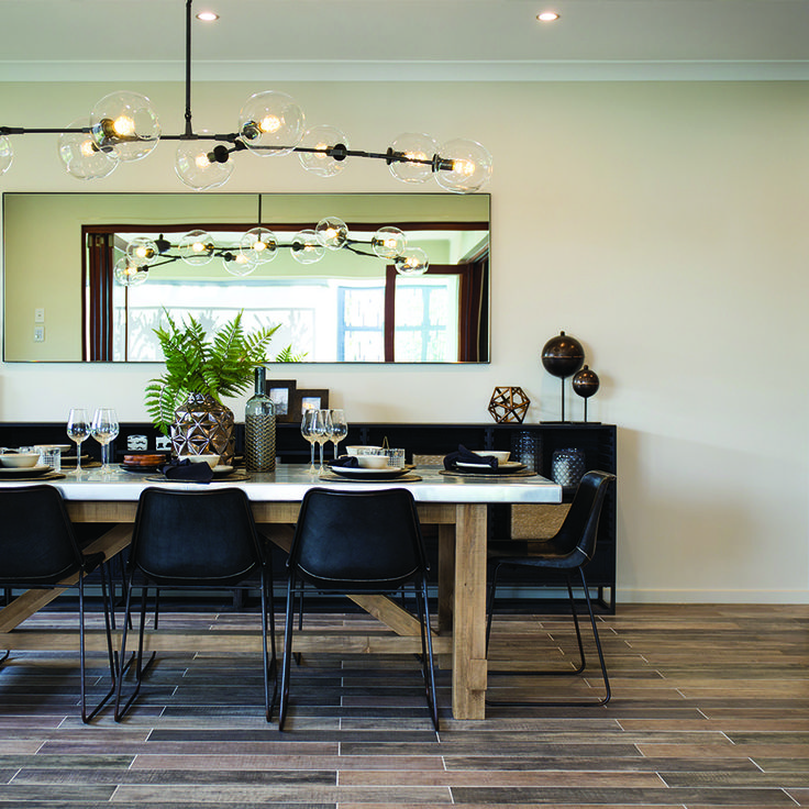 What a beautiful dining room! Timber look tiles showcased here in a @metricon Queensland home.  #tilestyle #nationaltiles