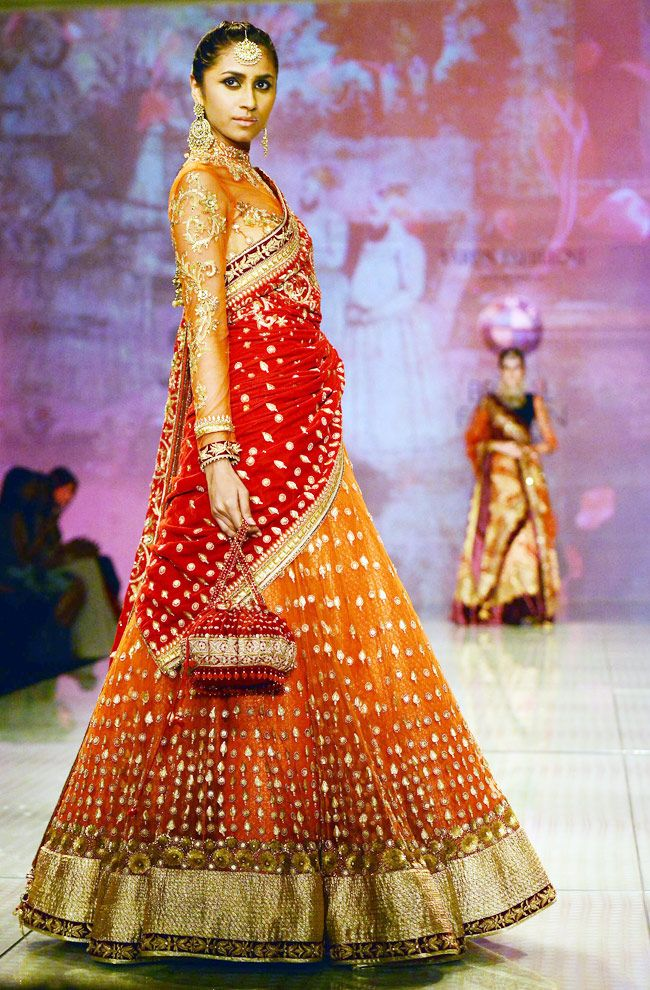 The way this orange and red lehenga looks like it's lit up with tiny, sparkly lights <3 #indian #wedding #bridal