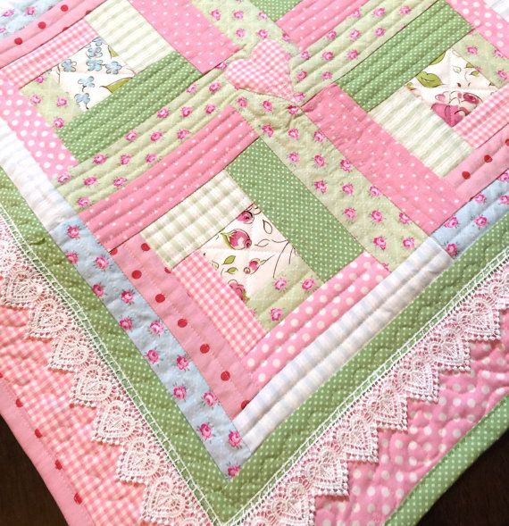Adorable Lace Baby Girl quilt with a modern log cabin cottage chic look. The pastel colors in this baby girl quilt include soft (warm) pinks, soft blues and sage greens add cottage charm to this whimsical white heart lace trimmed baby quilt. Appliqued hearts add whimsy to this baby blanket. Colors may vary slightly due to computer monitor.  Youll love the FEEL of the stitches of a custom quilt. Nothing cuddles you better than something handmade! Perfect size for your new baby to cuddle with…