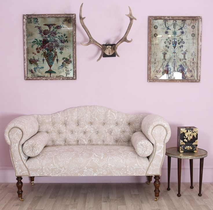 This superb traditional antique buttoned sofa is beautifully upholstered in Jacobean fabric with a pair of matching bolster cushions for additional