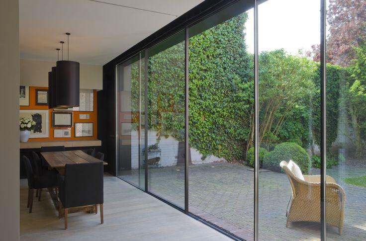 minimal windows creating a floor to ceiling rear patio door design