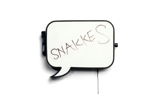 DESIGN BY DANIEL CORTAZAR  (2010)    Snakkes is a wall mounted LED speaking board, created to light up the wall and to write a text or comment on with a wipeable marker pen.