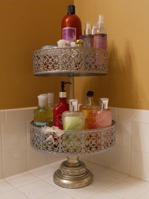 cake stand to organize items that clutter the bathroom countertop