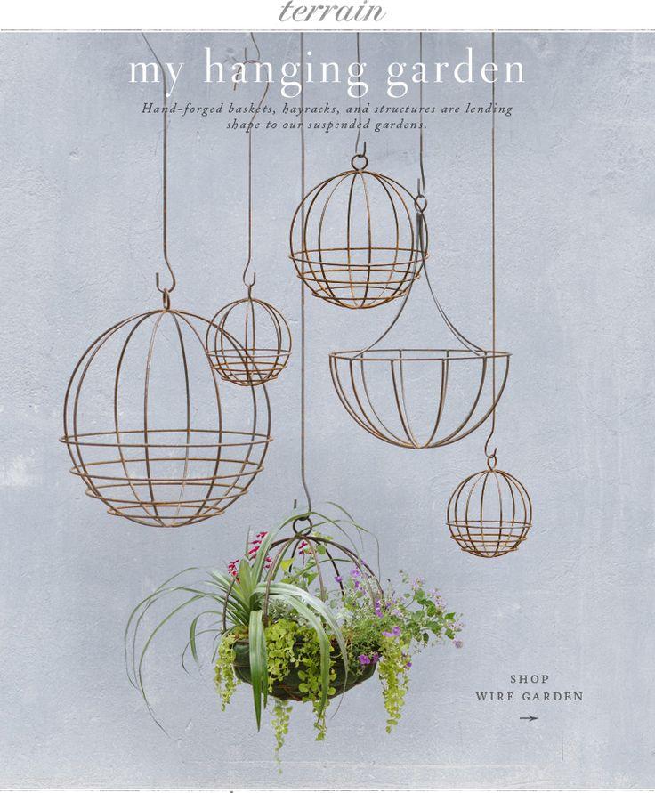 Hanging planters at terrain.com. Love them.