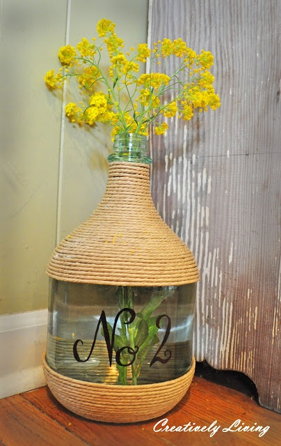 Twine wrapped wine jug. Awesome on the porch with flowers