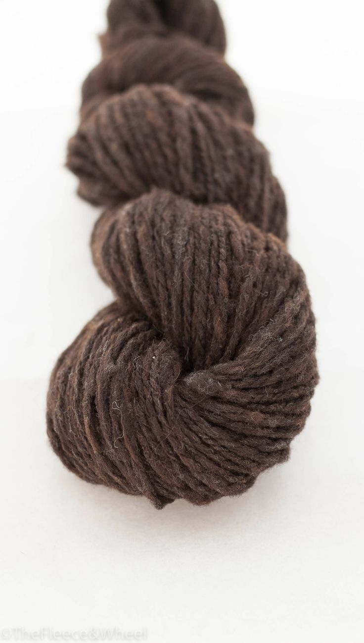 Handspun yarn from raw Australian cormo wool left undyed in it's natural chocolate brown.