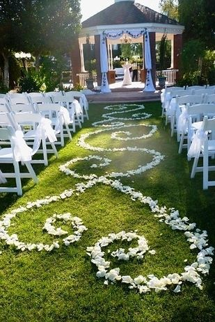 love the garden and the colorfull of white Form an aisle runner out of rose petals. | 31 Impossibly Romantic Wedding Ideas