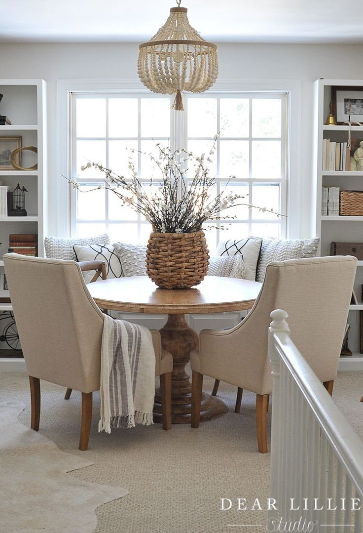 We love using baskets as vases and filling them with flowers including this one from HomeGoods! It works great at this round game table in our bonus room. (sponsored pin)