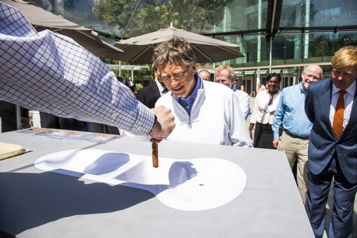 Bill Gates weighs evaluates the Toronto Toilet at the Reinvent the Toilet fair in Seattle
