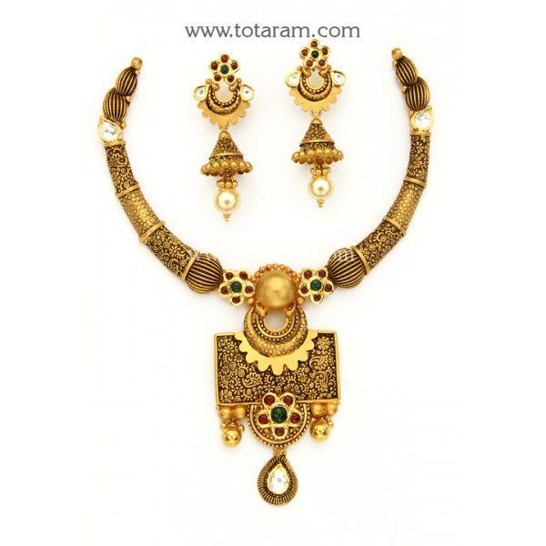 22 Karat Gold Antique Necklace & Drop Earrings Set with Fancy Stones & intricate workmanship Gross Gold Weight : 70.650 grams Screw Type : Bombay Screw   Gross Gold Weight of Necklace : 45.400 grams Gross Gold Weight of Earrings : 25.
