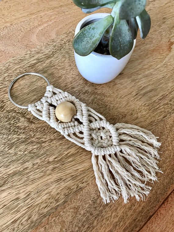 Handmade oversized macramé keychain. Made using 3mm cotton cord and wooden bead…