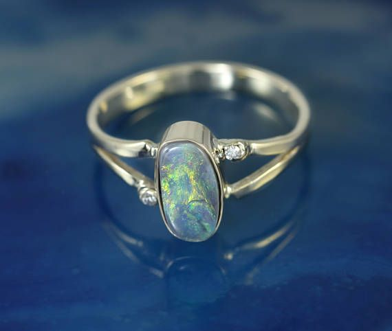 Check out this item in my Etsy shop https://www.etsy.com/au/listing/539632829/black-opal-solid-gold-14k-ring-split
