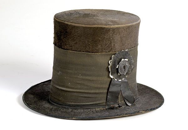Beaver Top Hat featuring silk black band and mourning button commemorating…