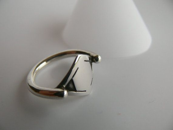Sterling silver ring with round band and modern design, by Evesbeads, $75.00