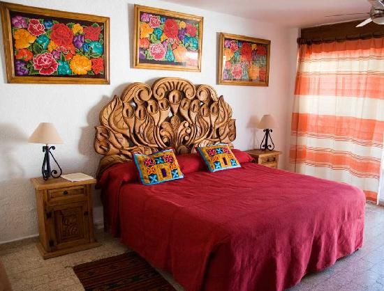 Mexican-inspired bedroom...wow, look at that headboard!