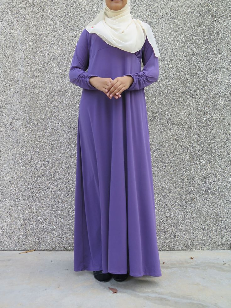 'Aisyah Humaira was designed to facilitate fuss-free nursing access. The criss-cross convenience stretch access (refer to thumbnail) is a must-have basic piece for nursing mothers on-the-go. Made from quality lycra that doesn't cling to skin, this basic nursing wear makes a second appearance with ruffled sleeves at the wrists. Simple, basic wear with a touch of girlish playfulness.  Colour: Royal Purple (Colour stands true to the nursing access thumbnail picture)