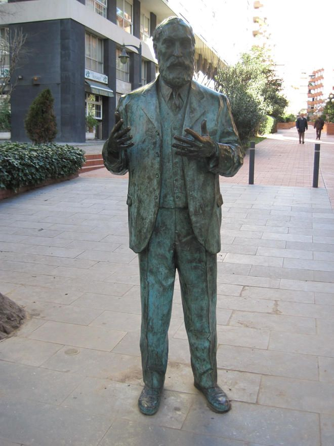 """This Statue is located on Passeig de Manuel Girona. It is of Antoni Gaudi, who gave Catalan architecture and modernisme world world renowned recognition. He could be considered a modern hero in the community. This is a """"free standing"""" statue, where he appears casual and friendly, fully immersed into society."""