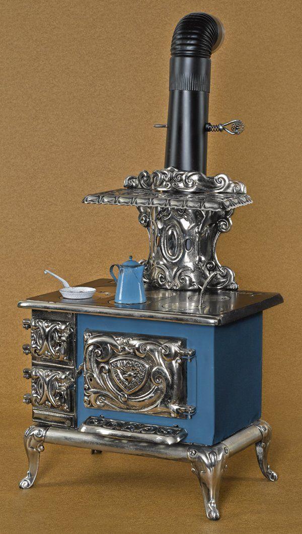 Buck's Stove & Range Co. cast iron and nickel Buck's Junior 4 salesman sample stove, 22'' h., 15'' w