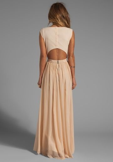 Love this..if you wore a thin lace tank underneath so that's what you would see in the open back that would be gorgeous!