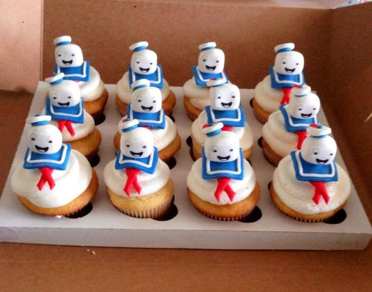 Mr stay puff marshmallow man cupcakes. Heads are gumpaste and edible paper. Homemade vanilla cake and buttercream