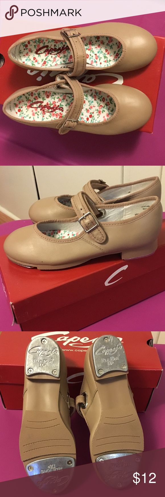 Girls Capezio Caramel Tap Shoes Girls Size 12 1/2 Capezio Caramel Tap Shoes.  Leather upper; Velcro buckle.  Like new condition. Had to purchase toward the ending of daughters dance class because she outgrew the ones she started with so these were hardly used.  Pics show shoes have no scratch or scuff marks. Smoke-free, Pet-free home Capezio Shoes Dress Shoes
