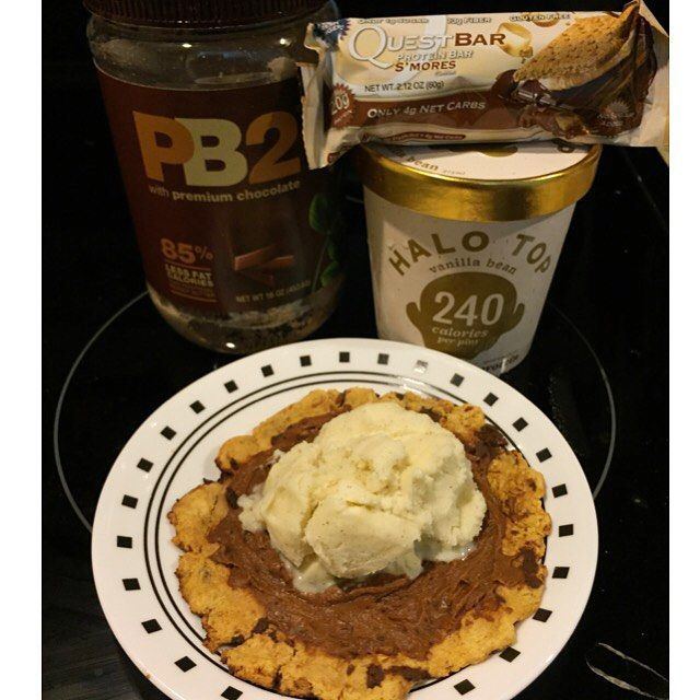 Quest Cookie Cake topped with a scoop of @halotopcreamery protein ice cream!  All this for under 300 calories!!!  Heat a Quest Bar for 15 seconds in the microwave in order to mold & flatten into a flat cookie cake. Bake cookie for 4-5 minutes in the oven set at 350. Use 2 tbsp of Chocolate PB2 for chocolate icing. Topped with my favorite healthy protein ice cream by Halo Top!