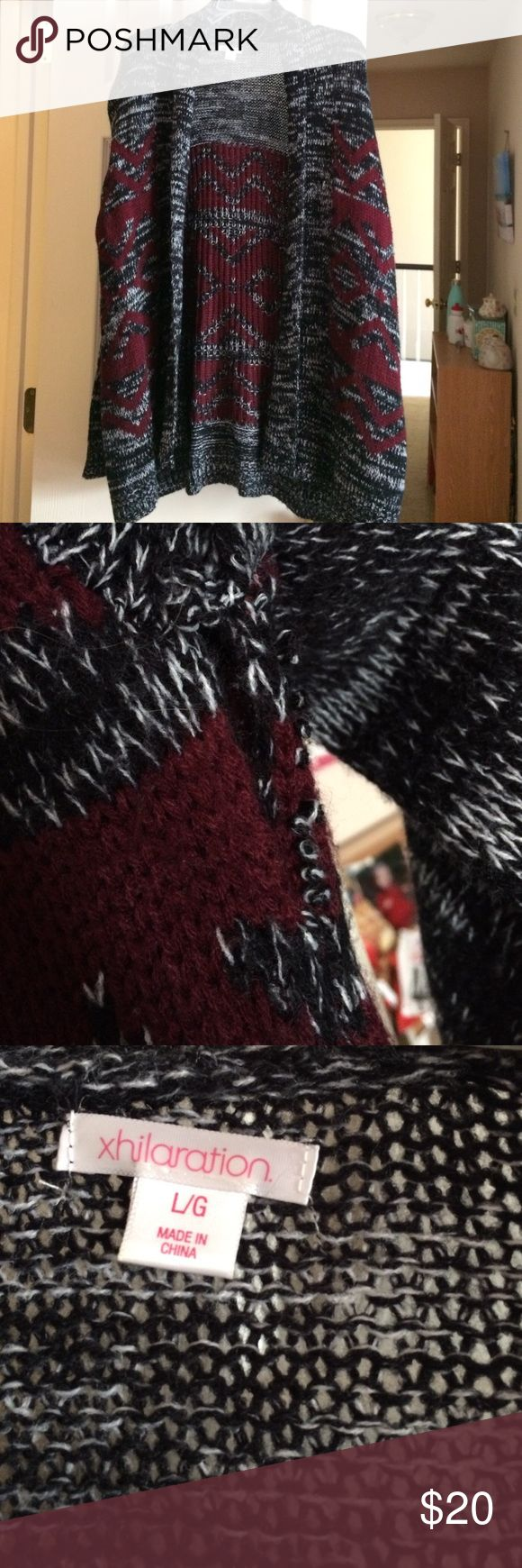 Cardigan Cardigan with maroon design. Hole in one arm pit area. Could easily be sown back. Other than that, great condition. Xhilaration Sweaters Cardigans