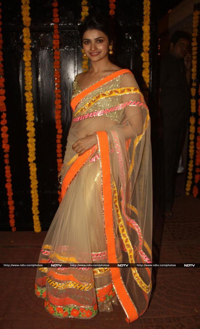 Prachi Desai in a Kunal Anil Tanna net sari with neon borders